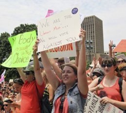 Women's rights activists seen at a pro-choice rally in Austin.